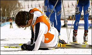 Per Elofsson collapses at the finishing line of the cross-country pursuit