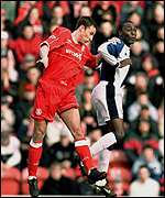 Middlesbrough's Gareth Southgate jumps with Blackburn's Andy Cole