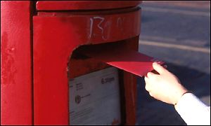Posting a letter at a post box