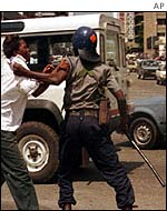 Policeman arrests opposition supporter in Harare, 15 February