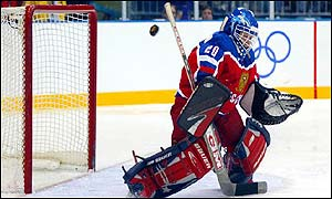 Russian goaltender Irina Gashennikova blocks a shot by China