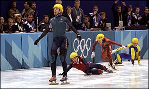 Steven Bradbury glides past to claim Australia's first ever Winter Olympics gold medal [Steve Munday/Getty Images]