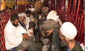 Afghan pilgrims sit aboard a British C-130 Hercules transport on a flight to Mecca
