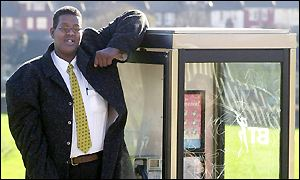 Hussain Bisad, leaning on the top of a phone box