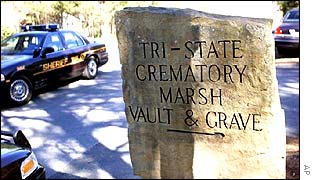 Sign for Georgia crematorium with police car in background