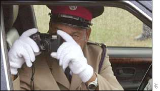 The Queen's car driver taking a picture of her at National Heroes Park