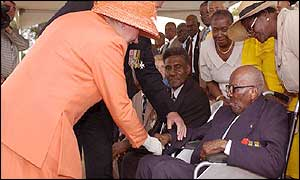 The Queen meets 107-year-old First World War veteran Eugent Clarke (right) at Heroes Circle, Kingston