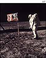 Astronaut Buzz Aldrin poses beside the US flag on the Moon