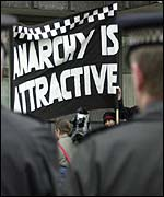 Anarchist campaigners at a police rally with banner reflecting Mr Paddick's comments