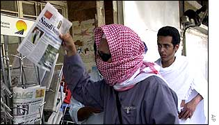 A pilgrim browses at a newspaper stand in Mecca
