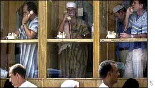 Pilgrims talk on telephones in the holy city of Mecca