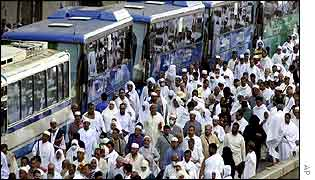 Pilgrims leave the grand mosque in Mecca to make the short journey to Mount Arafat