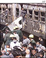 Rescue workers at burnt out train