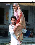 Woman carried to vote