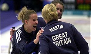 Britain celebrate their 6-5 defeat of Canada