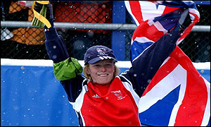 Alex Coomber proudly flies the Union flag after winning her bronze medal