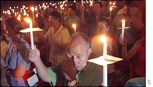 Residents of Neiva light candles to protest