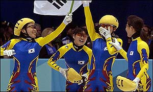 Choi Min-kyung celebrates after crossing the line first