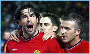 Ruud Van Nistelrooy celebrates scoring with his Man Utd team-mates