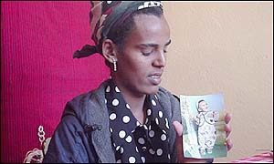 Ethiopian Fireweni Hailu holds a picture of her two-year-old son