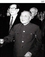Deng Xiaoping (centre), with Jiang Zemin in background, photographed in 1997