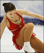 Michelle Kwan picks herself up after a tumble