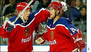 Russia's Alexei Zhamnov and Valeri Bure celebrate a goal in the ice hockey