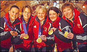 Great Britain's women's curlers celebrate Olympic gold