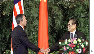 President Bush and Chinas President Jiang Zemin shake hands at the end of press conference