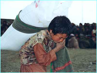 This boy was lucky - he received 50 kilos of grain in Maslakh camp, enough to feed his family 2-3 months