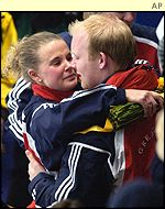 Fiona MacDonald hugs husband Ewan after winning gold