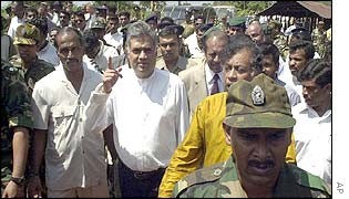 Prime Minister Ranil Wickramasinghe points towards Tiger-held territory