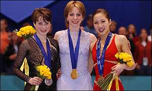 Slutskaya joins Sarah Hughes and Michelle Kwan on the winners podium