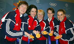 Britain's successful curling team celebrate with their gold medals