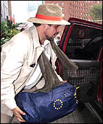 An EU observer leaves Harare