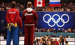 The Russians and Canadians stand on the top step of the podium together after both being awarded gold
