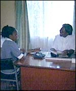 Alice Njoki (left) with a clinic worker