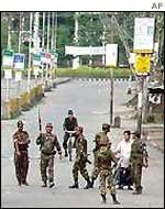 Indian troops patrol a street in Manipur