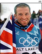 Scot Alain Baxter with a Union Flag after his medal win