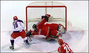 Goalkeeper Sergei Shabanov of Belarus makes a save on a shot by Pavel Bure