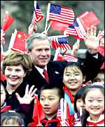 President George W Bush with his wife Laura and Chinese children