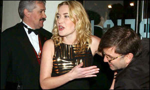 Kate Winslet is cleaned up after taking a tumble in the rain