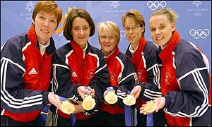 Britain's women curlers show off their gold medals