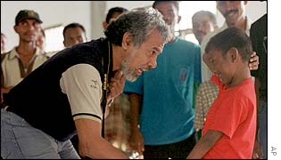 Xanana Gusmao East Timorese chats with a child at a community meeting
