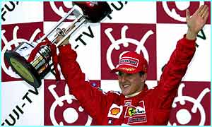 Ferrari's Michael Schumacher of Germany waves his trophy after winning the Japanese Grand Prix in 2001