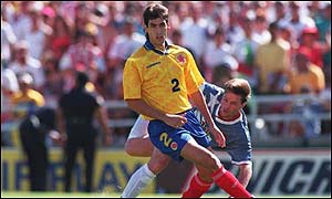 Andreas Escobar shields the ball from Eric Wynalda during the fateful match in which his own goal helped condemn Colombia to defeat
