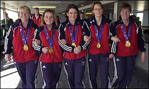 The GB team show off their medals on British soil