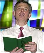 PM Tony Blair with a hymn book