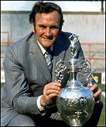 Former Leeds and England boss Don Revie poses with the 1974 championship trophy