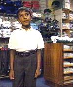 boy in uniform shop